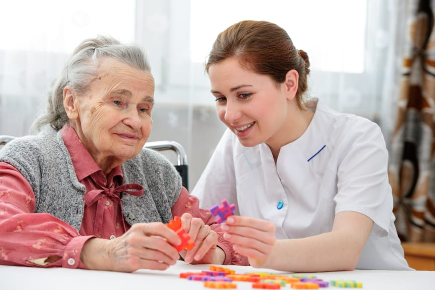 Senior woman with her domestic service employee
