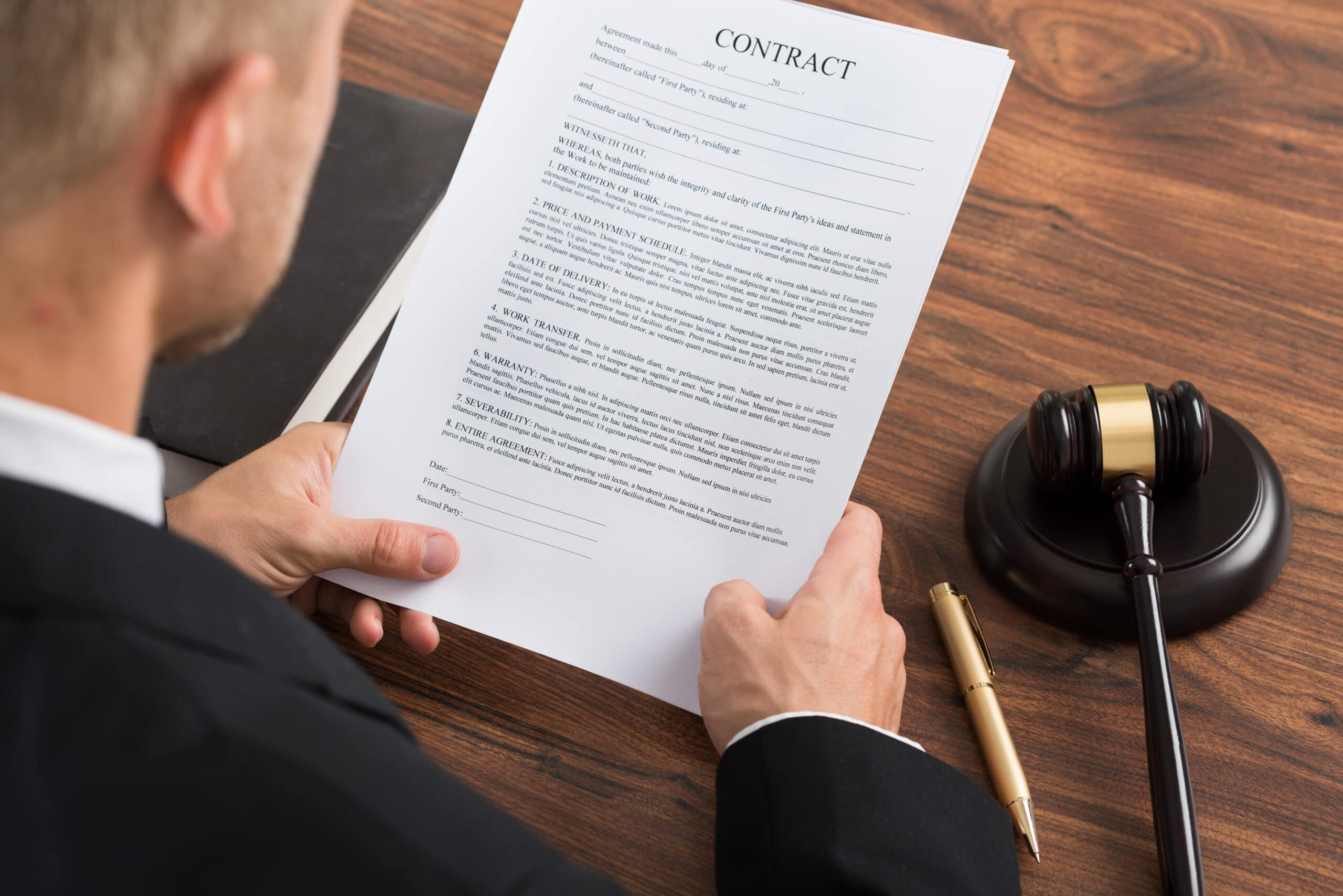 Judge Reading Contract