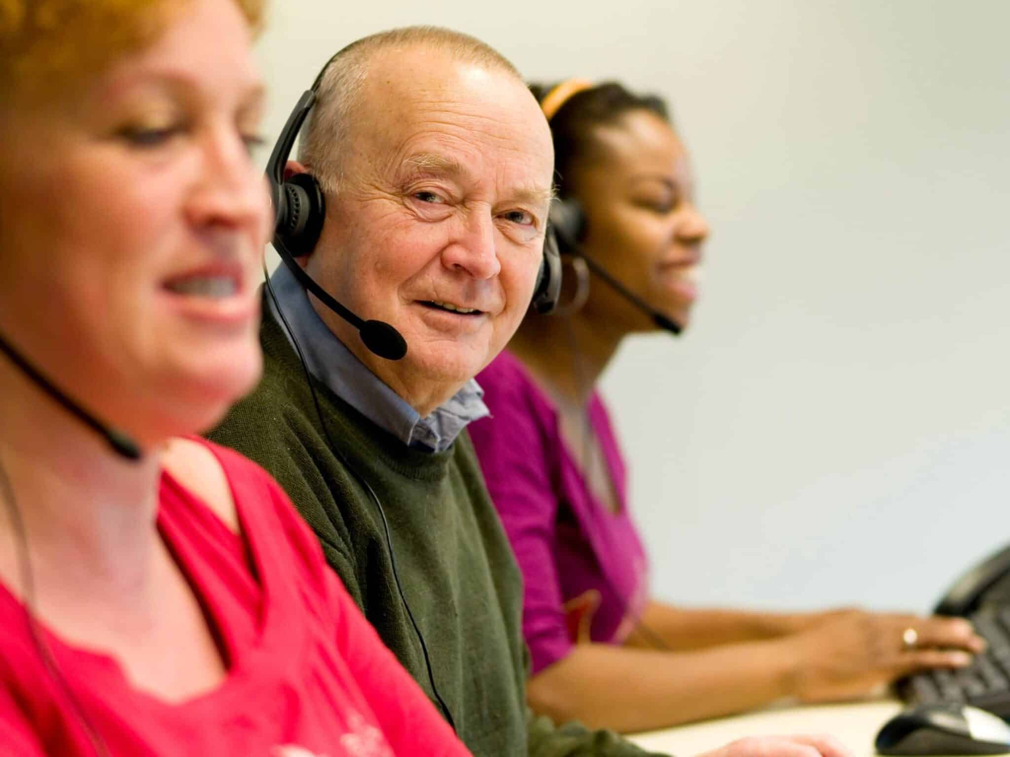 telemarketing employees of different ages and sexes with headsets on