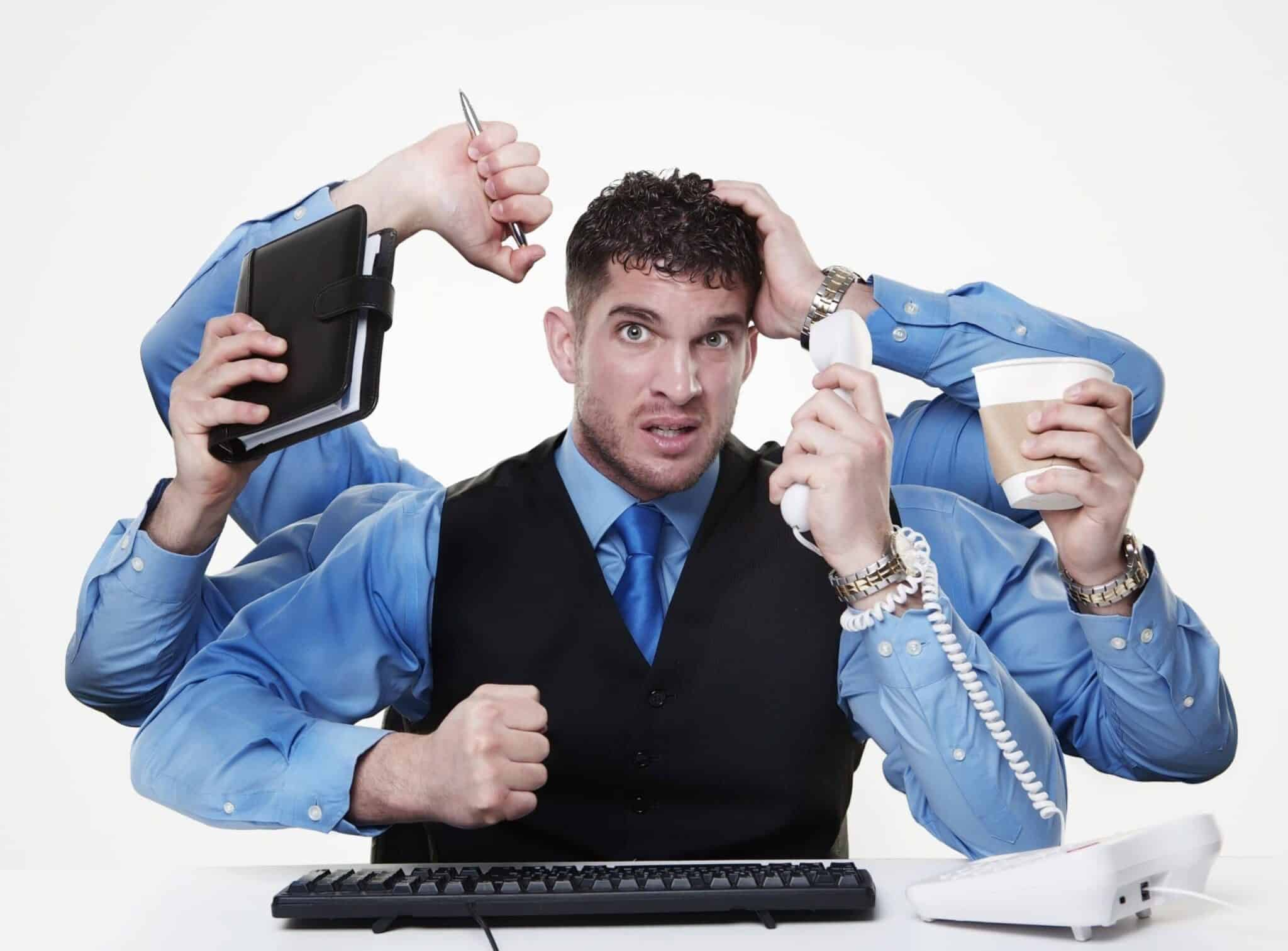 individual businessperson trying to perform and handle more than one task at the same time, not doing very from the looks of things