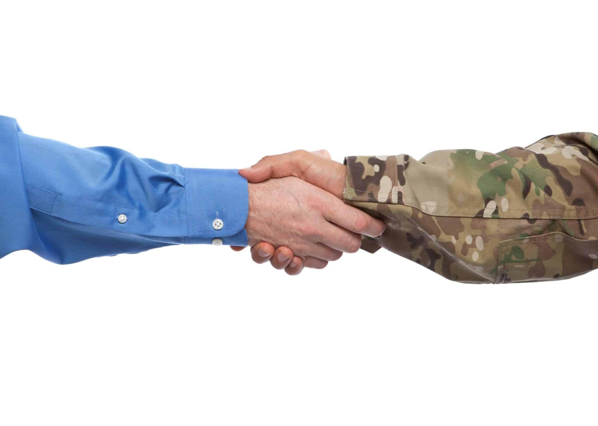 A veteran in uniform accepting a job offer