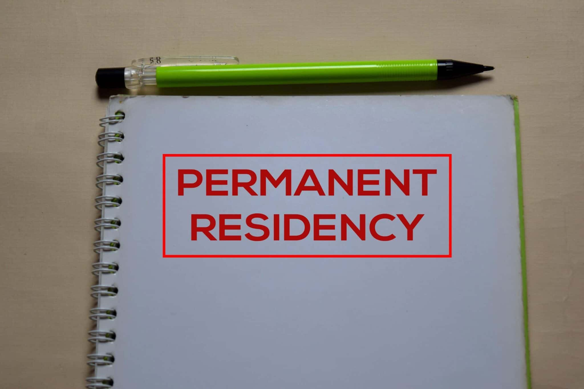 Permanent Residency write on a book isolated on Office Desk
