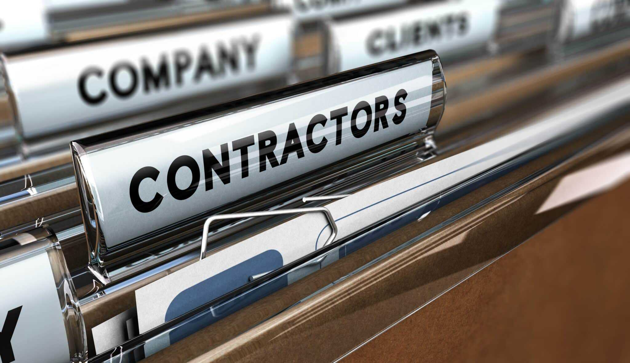 Close up on a file tab with the word contractors, focus on the main word and blur effect. Concept image for illustration of contractors or independent company database.
