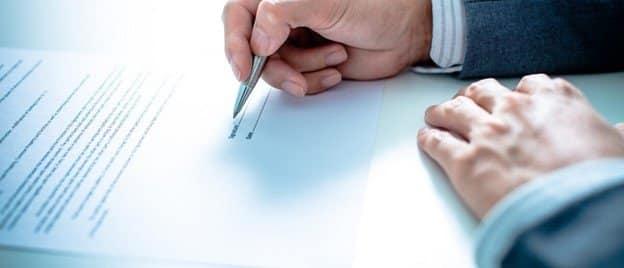 man-signing-employment-contract