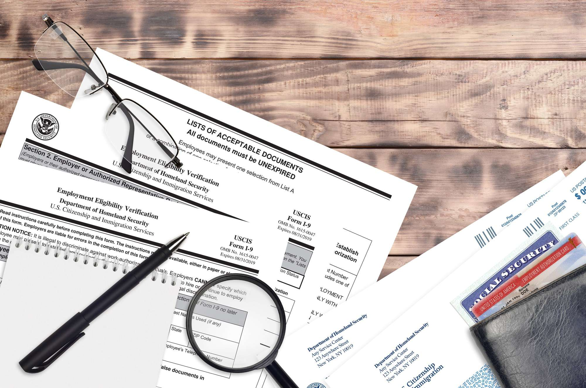 USCIS form I-9 Employment eligibility verification lies on flat lay office table and ready to fill. U.S. Citizenship and Immigration services paperwork.
