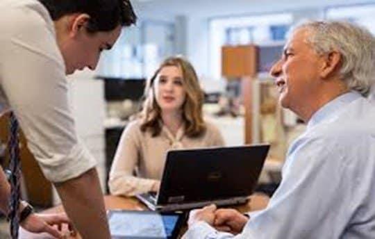 employees-talking-at-desk