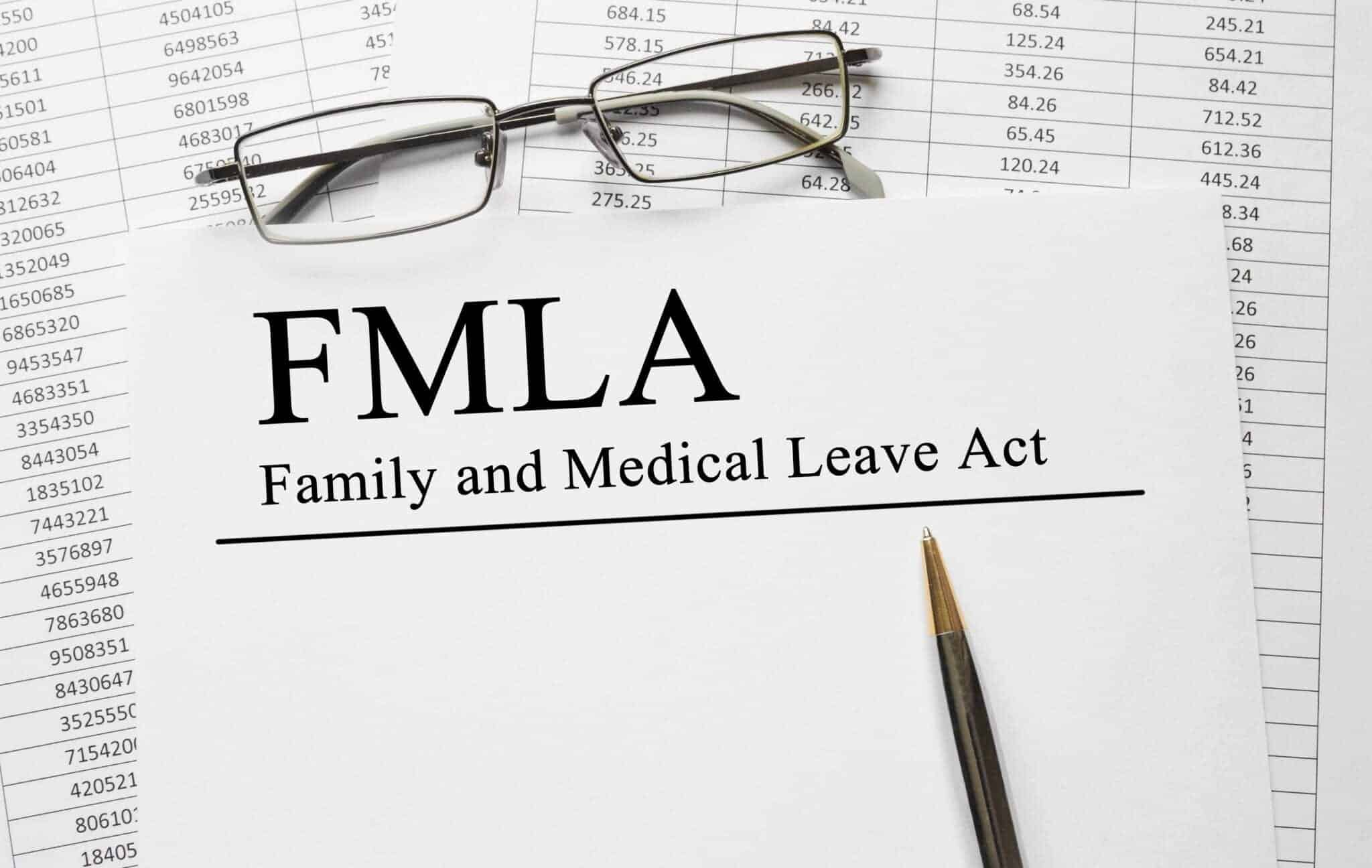Paper with Family Medical Leave Act FMLA on a table
